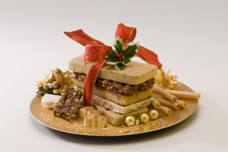 Typical Spanish Christmas nougat in a golden plate  White background