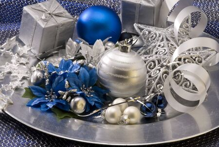 studioshot: Christmas arrangement. Decorated balls and ornaments in a plate.