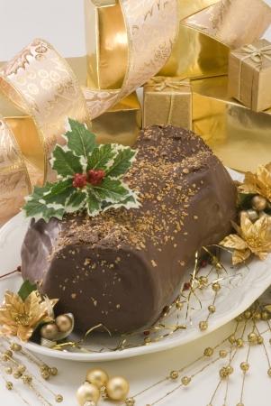 Hausgemachte Weihnachten Schokolade yule log Tronco de Navidad Buche de Noel Lizenzfreie Bilder
