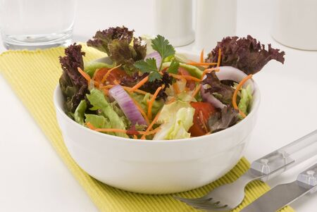 Fresh summer salad in a white bowl. Selective focus. Stock Photo - 15538335