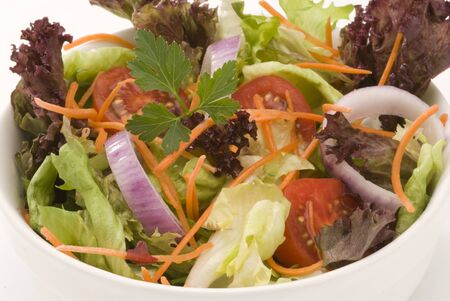 Closeup of a fresh summer salad in a white bowl. Selective focus. Stock Photo - 15538363