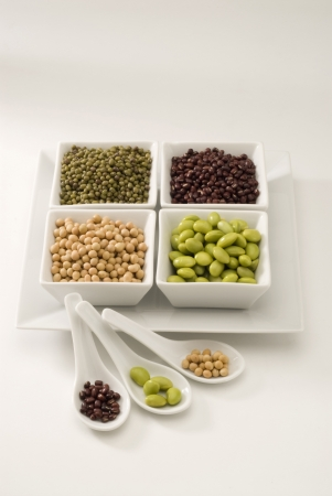 Assorted dried and fresh soybeans in square plates  Stock Photo