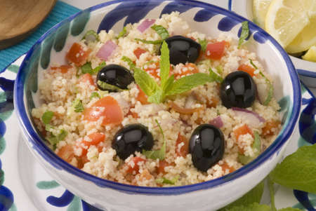 Tabouleh salad in a ceramic bowl Stock Photo - 15698745