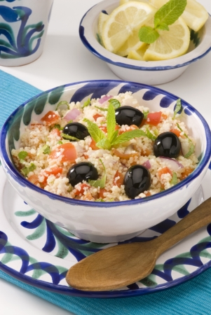 moroccan cuisine: Tabouleh salad in a ceramic bowl  Selective focus