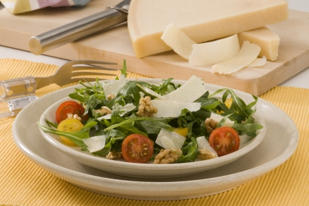 Rocket and parmesan shavings salad in a ceramic dish  Selective focus  Stock Photo - 15734064