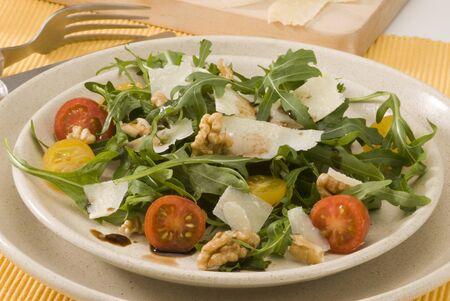 Rocket and parmesan shavings salad in a ceramic dish  Selective focus Stock Photo - 15734066