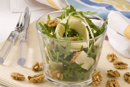 Rocket and parmesan shavings salad in a glass  Selective focus Stock Photo - 15734058