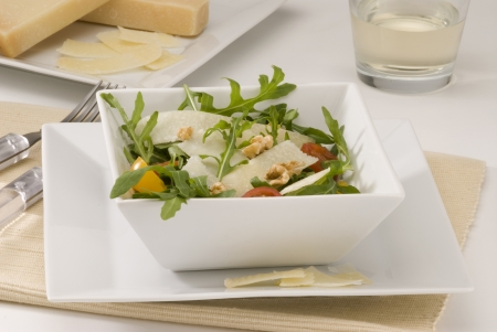 Rocket and parmesan shavings salad in a square plate  Selective focus  photo