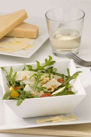 Rocket and parmesan shavings salad in a square plate  Selective focus Stock Photo - 15734042
