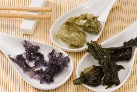 seaweeds: Edible seaweeds in white spoons  Selective focus