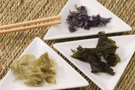 Edible seaweeds in white plates  Selective focus  Stock Photo