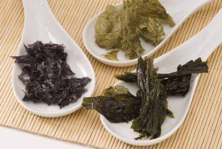 Edible seaweeds in white spoons  Selective focus