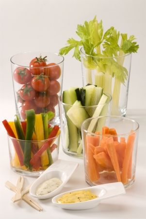 Crudites salad  Assorted vegetables sticks and dips  Selective focus  Stock Photo