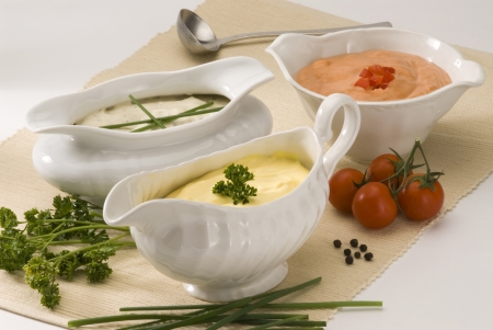 Mayonnaise cheese and cocktail sauces in sauceboats  Salad dressing  Stock Photo