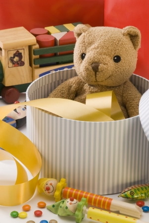 Teddy bear and  vintage toys in a box