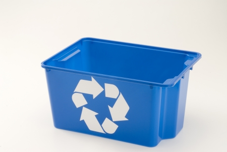 Empty blue recycling bin. White background. Stock Photo
