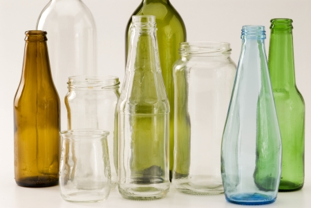 Household recycling materials. Glass bottles. White background. Stock Photo
