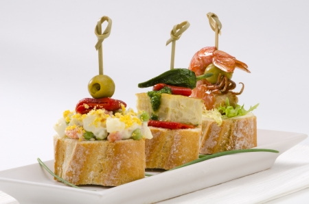 spanish tapas: Spanish cuisine. Montaditos. Sliced bread topped with a variety of appetizers. Spanish Tapas.