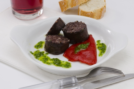 Spanish Tapas  Blood and rice sausage, Burgos Style, served  in a white plate  Morcilla de Burgos