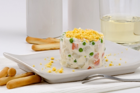 spanish tapas: Spanish Tapas. Russian salad in a white plate. Ensaladilla rusa. Selective focus.