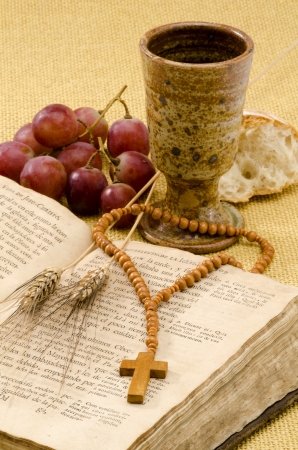 first communion: First Holy Communion composition on beige sackcloth  background Stock Photo