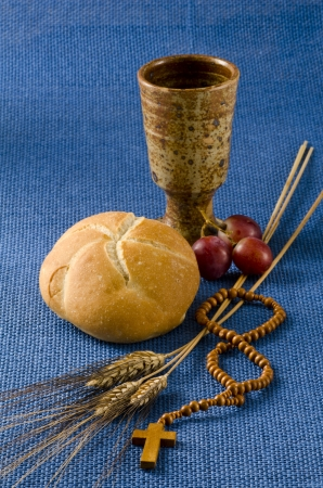 holy communion: First Holy Communion composition on blue background Stock Photo
