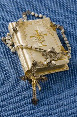 rosary beads: First Holy Communion Rosary and Religious Book on blue background