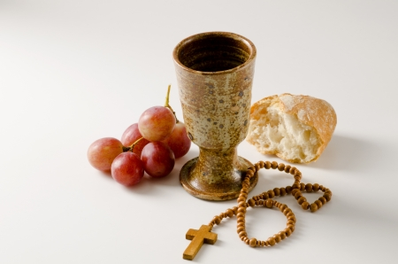 rosary beads: First Holy Communion composition on white background