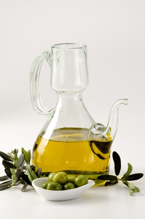 oilcan: Olive oil in an oilcan. White background.