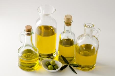 oilcan: Olive oil in bottles. White background. Stock Photo