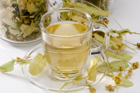 naturopathy: Lime Blossom Tea in a glass cup. Naturopathy. White Background. Selective Focus. Stock Photo