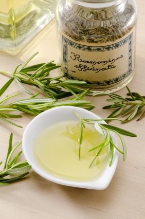 aromatherapy oil: Rosemary essential oil. Rosmarinus officinalis. Aromatherapy treatment. Selective focus. Stock Photo
