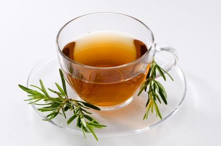 Rosemary Herbal Tea in a glass cup. Rosmarinus officinalis. Naturopathy. White Background.