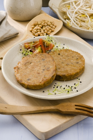 Vegetarian soy burger on a ceramic plate. Focus on foreground. Stock Photo - 20448104
