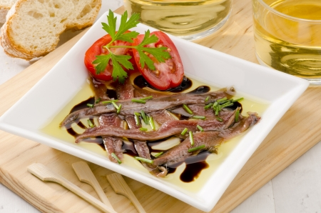 Spanish cuisine. Tapas. Marinated anchovies in olive oil. Selective Focus. Anchoas en aceite. Stock Photo