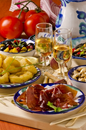 sherry: Spanish cuisine. Assortment of  Tapas including   Marinated Olives, Mussels in Sauce and  Fried Squid Rings.