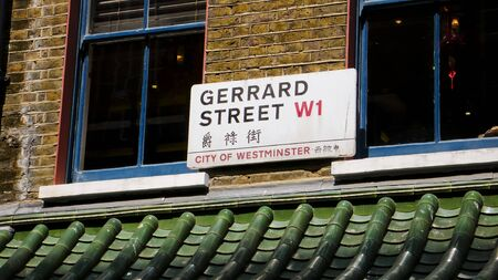 chinatown: London, United Kingdom - July 22, 2013: Gerrard Street sign in English and Chinese. Chinatown. Soho District.