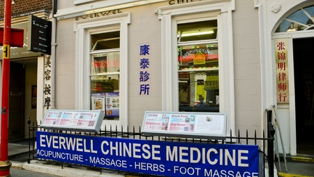 chinatown: London, United Kingdom - July 22, 2013: Chinese Medicine Shop at Gerrard Street, signs are in English and Chinese. Chinatown. Soho District. Editorial