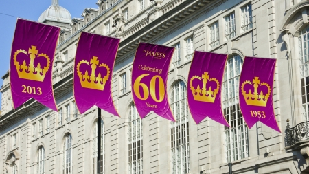 festooned: London, United Kingdom - July 19, 2013: Regent Street is festooned with purple and gold flags for the 60th. anniversary of the Coronation of Her Majesty the Queen Elizabeth II