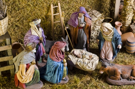 Christmas Crib. Adoration of The Three Wise Men. Baby Jesus in foreground.