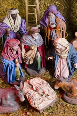 Christmas Crib. Adoration of The Three Wise Men. Baby Jesus in foreground. Stock Photo - 23117811