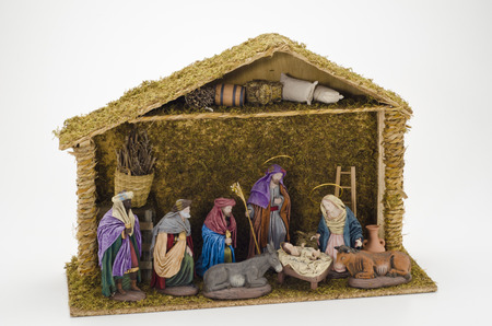 Christmas Crib. Adoration of The Three Wise Men. Baby Jesus in foreground. Stock Photo - 23117819