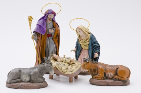 Christmas Crib. Figures of Baby Jesus, Virgin Mary and St. Joseph on white background. Stock Photo - 23117815