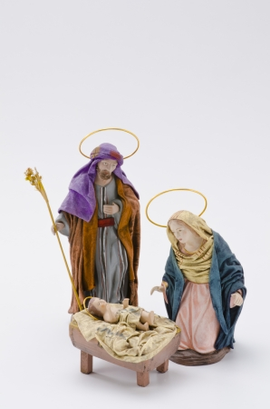 st  joseph: Christmas Crib. Figures of Baby Jesus, Virgin Mary and St. Joseph on white background.