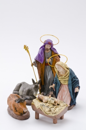 crib: Christmas Crib. Figures of Baby Jesus, Virgin Mary and St. Joseph on white background.