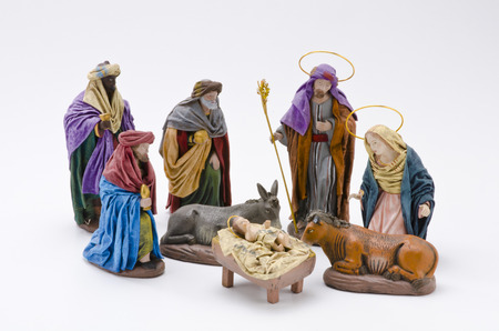 Christmas Crib. Adoration of The Three Wise Men. Baby Jesus in foreground. White Background.