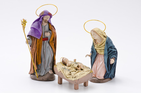 Christmas Crib. Figures of Baby Jesus, Virgin Mary and St. Joseph on white background. Stock Photo - 23117825