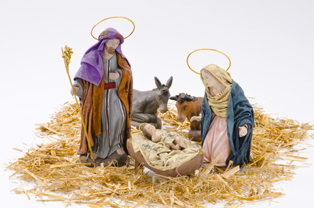 Christmas Crib. Figures of Baby Jesus, Virgin Mary and St. Joseph on white background.