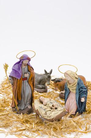 nascita di gesu: Presepe di Natale. Figure di Ges� Bambino, Maria e San Giuseppe su sfondo bianco.