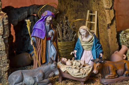 baby jesus: Nativity Crib. Figures of Baby Jesus, Virgin Mary and St. Joseph. Stock Photo